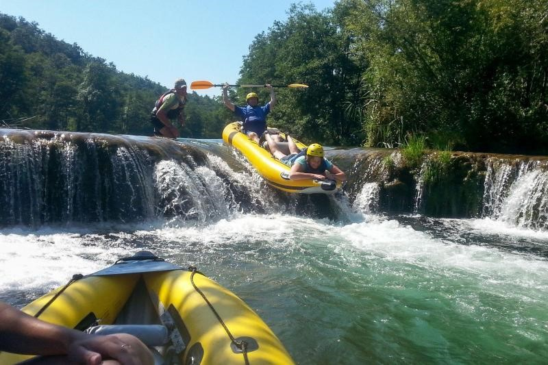 A group of people riding the rapids on a river