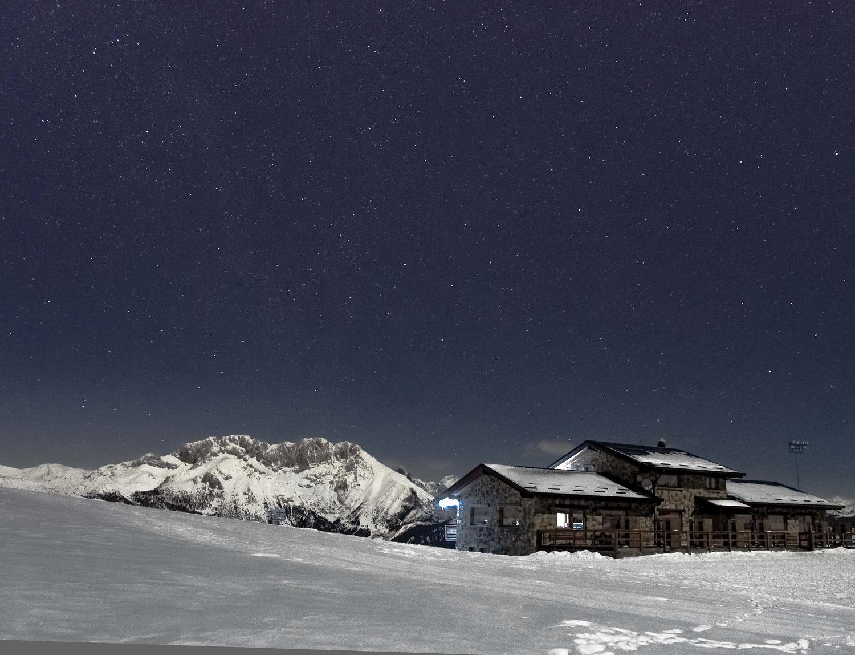 Ski slope at night under the stars