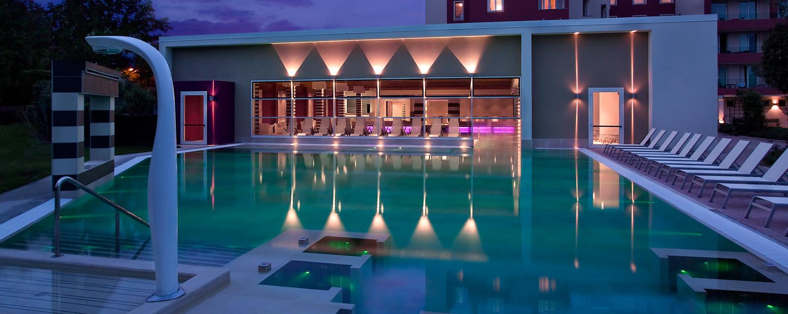 The Veranda and pool a dusk